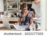 serious female model reviews... | Shutterstock . vector #1022177203