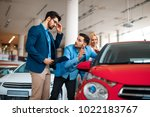 young couple choosing new car...   Shutterstock . vector #1022183767