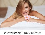 cute smiling woman with naked... | Shutterstock . vector #1022187907