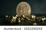 golden bitcoin coin and mound... | Shutterstock . vector #1022200243