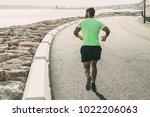 back view of strong man running ... | Shutterstock . vector #1022206063