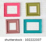four photo frames on the white... | Shutterstock . vector #102222337