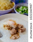 Small photo of Rice porridge with ground pock and egg, Thai Cuisine Beast Breakfast