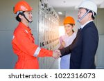 executives and electrical... | Shutterstock . vector #1022316073