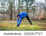 young male runner stretching in ... | Shutterstock . vector #1022317717
