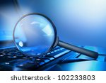 magnifying lens on the laptop... | Shutterstock . vector #102233803