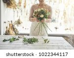 closeup of a female florist... | Shutterstock . vector #1022344117