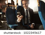 smiling young businessman...   Shutterstock . vector #1022345617