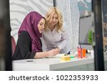 european woman and asian muslim ... | Shutterstock . vector #1022353933