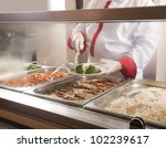 chef standing behind full lunch ...   Shutterstock . vector #102239617