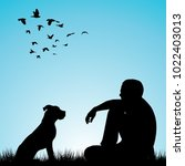 man and his dog sitting on... | Shutterstock .eps vector #1022403013