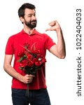 handsome man holding flowers... | Shutterstock . vector #1022404033