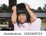 angry asian cute girl screaming ... | Shutterstock . vector #1022405713