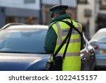 traffic warden civil... | Shutterstock . vector #1022415157