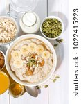 bowl of oatmeal with banana ... | Shutterstock . vector #1022415223