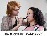 makeup artist working with a... | Shutterstock . vector #102241927