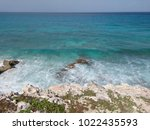 transparent waves of turquoise... | Shutterstock . vector #1022435593