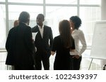diverse smiling businesspeople...   Shutterstock . vector #1022439397