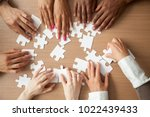Hands Of Diverse People...