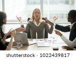 stressed businesswoman... | Shutterstock . vector #1022439817