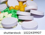 pills and medication on a white ... | Shutterstock . vector #1022439907