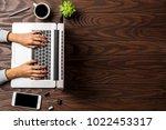 woman working on laptop  | Shutterstock . vector #1022453317