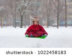 smiling boy sitting at slide on ... | Shutterstock . vector #1022458183