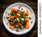 vegetable salad on wooden... | Shutterstock . vector #1022460073