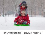 two boys riding at the slide on ... | Shutterstock . vector #1022470843