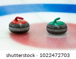 curling stones in the target on ... | Shutterstock . vector #1022472703