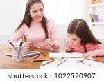 mother drawing with her... | Shutterstock . vector #1022520907