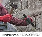 mason with chisel and hammer... | Shutterstock . vector #1022544313