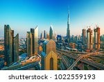 dubai skyline at sunset with... | Shutterstock . vector #1022559193