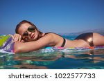 girl on the beach against a... | Shutterstock . vector #1022577733