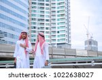 arab business walking and... | Shutterstock . vector #1022638027