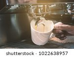 barista extract coffee by... | Shutterstock . vector #1022638957