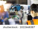 industry 4.0 robot concept ... | Shutterstock . vector #1022668387