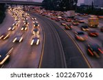 Heavy traffic on freeway at twilight - stock photo