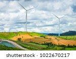 wind turbines farm on hill. the ... | Shutterstock . vector #1022670217