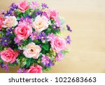 pink rose bouquet on wood table ... | Shutterstock . vector #1022683663