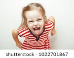 angry little girl shows her... | Shutterstock . vector #1022701867