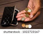an elderly person holds the... | Shutterstock . vector #1022723167