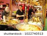 street food sellers  preparing... | Shutterstock . vector #1022740513