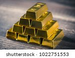 lots of gold bullion | Shutterstock . vector #1022751553