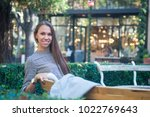smiling happy woman sitting on... | Shutterstock . vector #1022769643