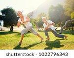 yoga at park. senior family... | Shutterstock . vector #1022796343