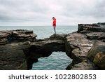male traveler standing on the...   Shutterstock . vector #1022802853