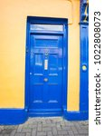 a blue door. | Shutterstock . vector #1022808073