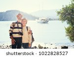 travel and tourism. senior... | Shutterstock . vector #1022828527