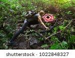 the traveler stands next to...   Shutterstock . vector #1022848327
